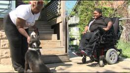 Spokeswoman Valetta Bradford and her son Xzavier Davis-Bilbo welcome back the recovered service dog Shi Shi